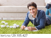 Купить «Handsome student working at startup project at home», фото № 29105427, снято 22 ноября 2017 г. (c) Elnur / Фотобанк Лори