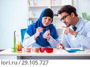 Купить «Dentist doctor and assistant working on new tooth implant», фото № 29105727, снято 24 апреля 2018 г. (c) Elnur / Фотобанк Лори