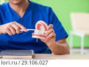 Купить «Man dentist working on new teeth implant», фото № 29106027, снято 28 мая 2018 г. (c) Elnur / Фотобанк Лори
