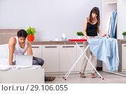 Купить «Young woman doing ironing for her husband», фото № 29106055, снято 27 июня 2018 г. (c) Elnur / Фотобанк Лори