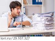 Купить «Overloaded busy employee with too much work and paperwork», фото № 29107327, снято 3 июля 2018 г. (c) Elnur / Фотобанк Лори