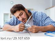 Frustrated young man due to weak internet reception. Стоковое фото, фотограф Elnur / Фотобанк Лори