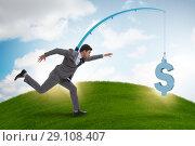 Businessman chasing money on fishing rod. Стоковое фото, фотограф Elnur / Фотобанк Лори