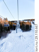 Купить «Chair lift in a ski resort in the early morning», фото № 29110667, снято 6 января 2018 г. (c) Евгений Ткачёв / Фотобанк Лори