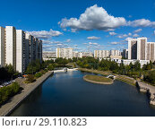 Купить «view from height of city pond and houses in Zelenograd in Moscow, Russia», фото № 29110823, снято 17 сентября 2018 г. (c) Володина Ольга / Фотобанк Лори