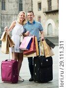 Купить «Couple with many bags outdoors», фото № 29111311, снято 19 октября 2018 г. (c) Яков Филимонов / Фотобанк Лори