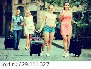 Купить «Two young traveling girls walking in city», фото № 29111327, снято 16 декабря 2018 г. (c) Яков Филимонов / Фотобанк Лори