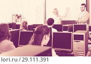 Купить «Employees working at office», фото № 29111391, снято 16 января 2019 г. (c) Яков Филимонов / Фотобанк Лори