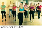 Купить «Positive energetic people dancing together», фото № 29111399, снято 9 октября 2017 г. (c) Яков Филимонов / Фотобанк Лори