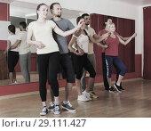 Купить «Group of happy people dancing salsa», фото № 29111427, снято 21 сентября 2018 г. (c) Яков Филимонов / Фотобанк Лори