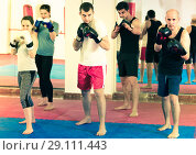 Купить «Portrait of females and males training in boxing gloves», фото № 29111443, снято 5 мая 2017 г. (c) Яков Филимонов / Фотобанк Лори