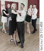 Купить «Young adults enjoying of classical dance», фото № 29111459, снято 21 сентября 2018 г. (c) Яков Филимонов / Фотобанк Лори