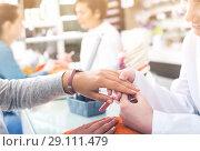 Купить «Manicurists giving manicure», фото № 29111479, снято 28 апреля 2017 г. (c) Яков Филимонов / Фотобанк Лори