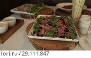 Купить «Snack on the tray On a sunny day on a white tablecloth», видеоролик № 29111847, снято 9 августа 2018 г. (c) Aleksejs Bergmanis / Фотобанк Лори