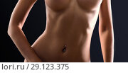 Купить «Crop photo of perfect female body. Navel piercing», фото № 29123375, снято 3 июля 2017 г. (c) katalinks / Фотобанк Лори