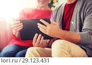 Купить «senior couple with tablet pc at christmas», фото № 29123431, снято 14 сентября 2017 г. (c) Syda Productions / Фотобанк Лори