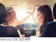 Купить «happy teenage girls or women driving in car», фото № 29123499, снято 7 июня 2016 г. (c) Syda Productions / Фотобанк Лори