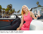 Купить «happy young woman in convertible car», фото № 29123607, снято 17 августа 2017 г. (c) Syda Productions / Фотобанк Лори