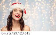 Купить «woman with red lipstick in santa hat on christmas», фото № 29123615, снято 5 января 2018 г. (c) Syda Productions / Фотобанк Лори