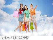 Купить «happy female friends with shopping bags», фото № 29123643, снято 30 июня 2018 г. (c) Syda Productions / Фотобанк Лори