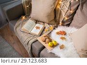 Купить «lemons, book, almond and oatmeal cookies on sofa», фото № 29123683, снято 15 ноября 2017 г. (c) Syda Productions / Фотобанк Лори