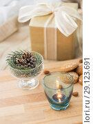 Купить «christmas fir decoration, candle, cookies and gift», фото № 29123691, снято 15 ноября 2017 г. (c) Syda Productions / Фотобанк Лори