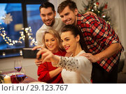 Купить «friends taking selfie at christmas dinner», фото № 29123767, снято 17 декабря 2017 г. (c) Syda Productions / Фотобанк Лори