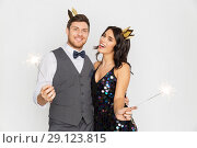 Купить «happy couple with crowns and sparklers at party», фото № 29123815, снято 15 декабря 2017 г. (c) Syda Productions / Фотобанк Лори