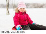 Купить «happy little girl on sled outdoors in winter», фото № 29123835, снято 10 февраля 2018 г. (c) Syda Productions / Фотобанк Лори