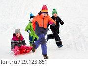 Купить «happy kids with sled having fun outdoors in winter», фото № 29123851, снято 10 февраля 2018 г. (c) Syda Productions / Фотобанк Лори