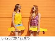 Купить «teenage girls with short skateboards outdoors», фото № 29123875, снято 19 июля 2018 г. (c) Syda Productions / Фотобанк Лори
