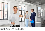realtor with folder pointing at you at office. Стоковое фото, фотограф Syda Productions / Фотобанк Лори