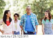 Купить «group of happy international friends in park», фото № 29123911, снято 10 июня 2018 г. (c) Syda Productions / Фотобанк Лори