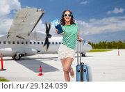 Купить «teenage girl with travel bag and airplane ticket», фото № 29124039, снято 30 июня 2018 г. (c) Syda Productions / Фотобанк Лори