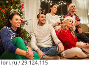 Купить «friends celebrating christmas and drinking wine», фото № 29124115, снято 17 декабря 2017 г. (c) Syda Productions / Фотобанк Лори