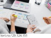 Купить «web designers working on user interface project», фото № 29124151, снято 17 января 2018 г. (c) Syda Productions / Фотобанк Лори