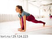 Купить «woman making high lunge exercise at yoga studio», фото № 29124223, снято 21 июня 2018 г. (c) Syda Productions / Фотобанк Лори