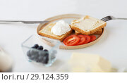 Купить «toasts with poached egg and vegetables on plate», фото № 29124359, снято 19 октября 2017 г. (c) Syda Productions / Фотобанк Лори