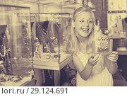 Купить «girl choosing earrings in bijouterie boutique», фото № 29124691, снято 10 декабря 2019 г. (c) Яков Филимонов / Фотобанк Лори