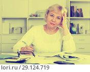 Купить «Woman engaged in home accounting», фото № 29124719, снято 14 ноября 2017 г. (c) Яков Филимонов / Фотобанк Лори