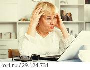 Купить «Mature woman with laptop», фото № 29124731, снято 14 ноября 2017 г. (c) Яков Филимонов / Фотобанк Лори