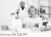 Купить «MAture woman and doctor», фото № 29124751, снято 14 ноября 2017 г. (c) Яков Филимонов / Фотобанк Лори