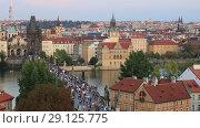 Купить «Прага. Красивый вид на город, крыши домов, набережную реки Влтава и Карлов мост сверху», видеоролик № 29125775, снято 19 сентября 2018 г. (c) Яна Королёва / Фотобанк Лори