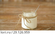 Купить «yogurt or sour cream in glass jar on wooden table», видеоролик № 29126959, снято 21 августа 2018 г. (c) Syda Productions / Фотобанк Лори