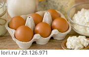 chicken eggs, milk, sour cream and cottage cheese. Стоковое видео, видеограф Syda Productions / Фотобанк Лори