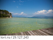 Купить «Beautiful Lake Garda in Italy, sunny summer day. September 7 2018», фото № 29127243, снято 7 сентября 2018 г. (c) Peredniankina / Фотобанк Лори