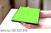 Купить «hands with chroma key green screen on tablet pc», видеоролик № 29127319, снято 19 января 2020 г. (c) Syda Productions / Фотобанк Лори