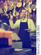 Купить «Seller offering sorts of meat», фото № 29128063, снято 2 января 2017 г. (c) Яков Филимонов / Фотобанк Лори