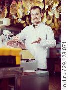 Купить «Seller weighing meat», фото № 29128071, снято 2 января 2017 г. (c) Яков Филимонов / Фотобанк Лори