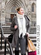 Купить «female with baggage in the city in scarf», фото № 29128223, снято 11 ноября 2017 г. (c) Яков Филимонов / Фотобанк Лори